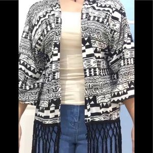 a black and white patterned cardigan